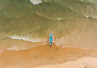 Aerial view of a traditional boat moored on the beach of Rio do Fogo, Brazil.