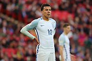 Dele Alli of England with hands on hips during the FIFA World Cup Qualifier group stage match between England and Lithuania at Wembley Stadium, London, England on 26 March 2017. Photo by Matthew Redman.