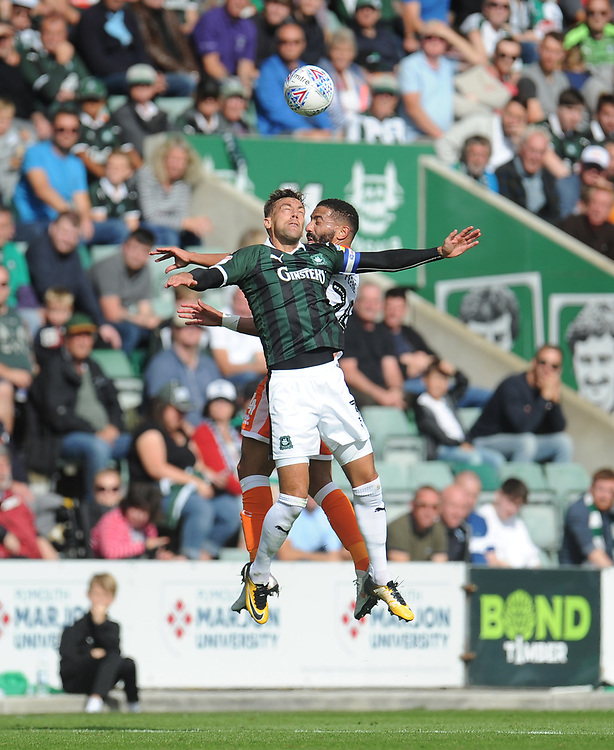Blackpool's Liam Feeney vies for possession with Plymouth Argyle's Gary Sawyer<br /> <br /> Photographer Kevin Barnes/CameraSport<br /> <br /> The EFL Sky Bet League One - Plymouth Argyle v Blackpool - Saturday 15th September 2018 - Home Park - Plymouth<br /> <br /> World Copyright © 2018 CameraSport. All rights reserved. 43 Linden Ave. Countesthorpe. Leicester. England. LE8 5PG - Tel: +44 (0) 116 277 4147 - admin@camerasport.com - www.camerasport.com