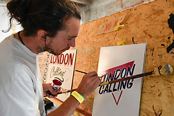 "© Licensed to London News Pictures. 17/08/2018. LONDON, UK. A sign writer practices at ""Letterheads 2018: London Calling"", an international gathering of professional sign writers and lettering artists from over 30 countries.  The event is taking place at the Bargehouse, Oxo Tower Wharf in central London untikl 19 August.  Photo credit: Stephen Chung/LNP"