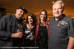Andreas Scholz with his wife at the Custom Chrome Europe party during the Intermot International Motorcycle Fair. Cologne, Germany. Friday October 5, 2018. Photography ©2018 Michael Lichter.