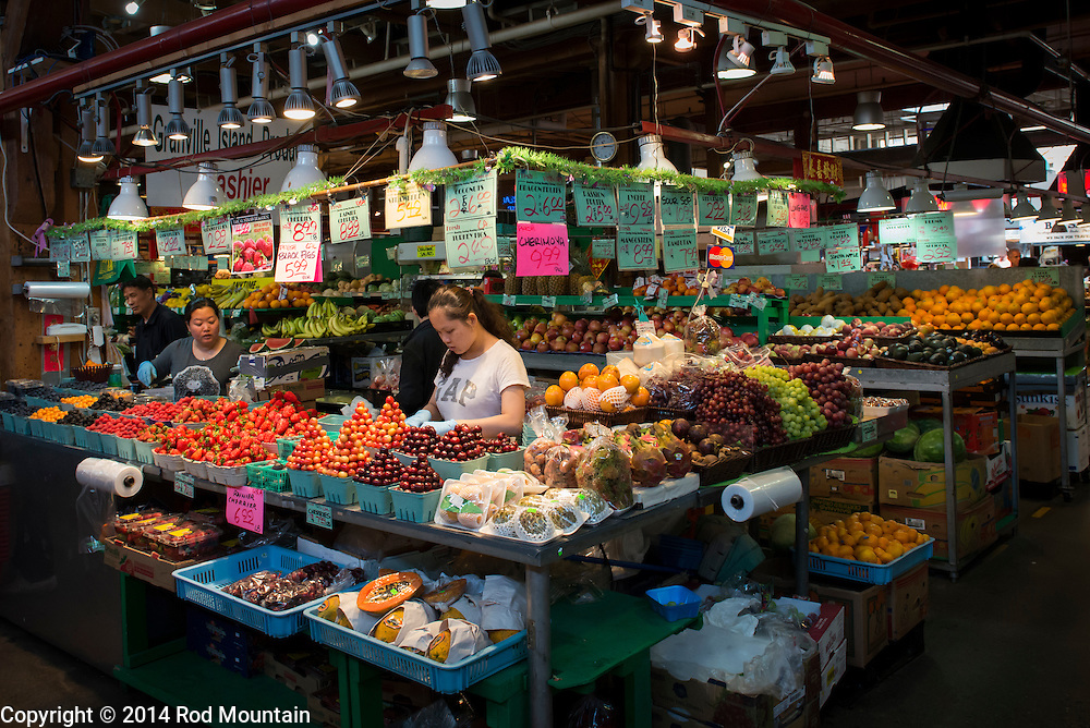 Pictured is one of the many shops offering fresh fruits and vegetables at Granville Island's Public Market. Vancouver, BC. <br /> <br /> Photo: © Rod Mountain<br /> <br /> http://www.rodmountain.com
