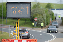 ©Licensed to London News Pictures 30/04/2020  <br /> Ebbsfleet, UK. Covid 19 road sign. A Coronavirus testing site for key workers has opened in Ebbsfleet, Kent. The site is mostly a self testing site by appointment only.<br /> Photo credit:Grant Falvey/LNP