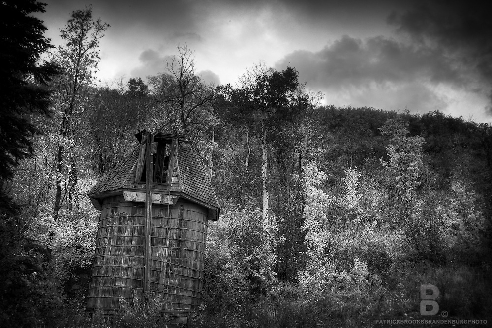 Black and white vintage wooden building in the mountains in Utah.
