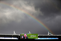 A rainbow emerges over the King Power Stadium before the match where a big screen displays a tribute image to Vichai Srivaddhanaprabha which reads 'Forever in our hearts'