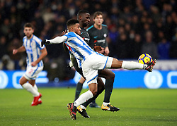 Huddersfield's Elias Kachunga (front) and Chelsea's Antonio Rudiger battle for the ball during the Premier League match at the John Smith's Stadium, Huddersfield.