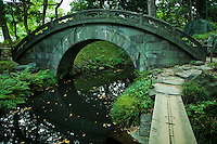 """Engetsukyo Bridge, or """"full moon bridge"""" built in the Chinese style at Koishikawa Korakuen Garden in Tokyo.  It has this name because a full moon is formed by the arch of the bridge and its reflection in the pond beneath."""
