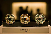 Ancient Chinese currency, copper coins, on display in the Shanghai Museum, China