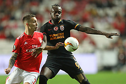 February 21, 2019 - Lisbon, Portugal - lex Grimaldo of SL Benfica (L) vies for the ball with Mbaye Diagne of Galatasaray AS (R) during the Europa League 2018/2019 footballl match between SL Benfica vs Galatasaray AS. (Credit Image: © David Martins/SOPA Images via ZUMA Wire)