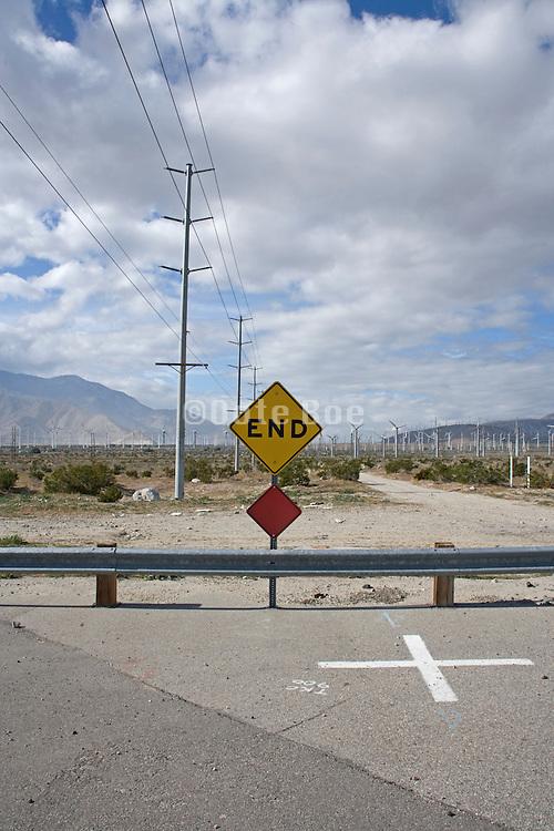 dead end road in an industrial dessert landscape California USA