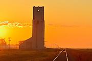 Grain elevator and railroad tracks at sunrise<br /> Culross<br /> Manitoba<br /> Canada