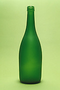 Still life of tall green bottle