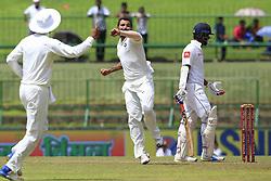 August 13, 2017 - Colombo, Sri Lanka - Indian cricketer Mohammed Shami(2R) celebrates after taking the wicket of Sri Lankan cricketer Dimuth Karunaratne(R) during the 2nd Day's play in the 3rd Test match between Sri Lanka and India at the Pallekele International cricket stadium, Kandy, Sri Lanka on Sunday 13 August 2017. (Credit Image: © Tharaka Basnayaka/NurPhoto via ZUMA Press)