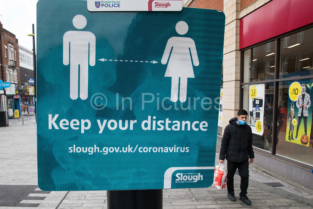 A Slough Borough Council sign reminds local residents to observe social distancing to help prevent the spread of the coronavirus on 23 October 2020 in Slough, United Kingdom. The Government has announced that Slough will change its COVID Alert Level status from Tier 1 Medium Alert to Tier 2 High Alert with effect from 00:01 on Saturday 24 October following a sustained rise in COVID-19 cases resulting in an infection rate of 153 cases per 100,000.