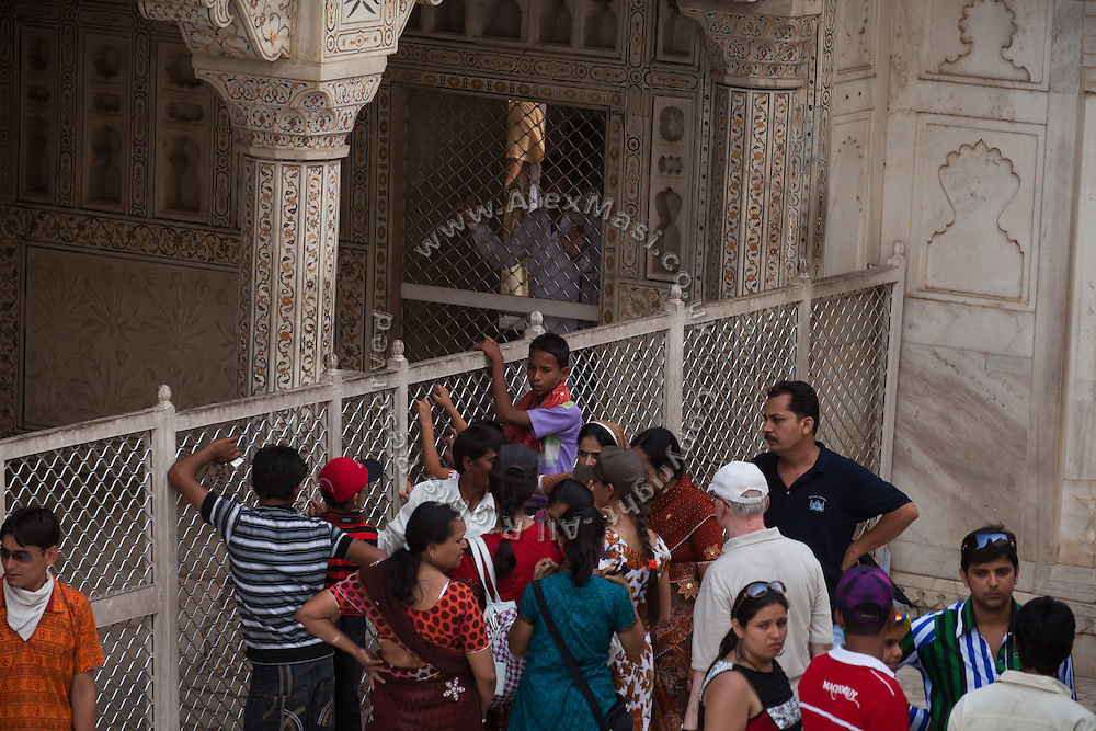 A crowd of visitors is looking at the protected section of the Agra Fort where deposed Mughal emperor Shah Jahan lived while under house arrest on orders of his son Aurangzeb.