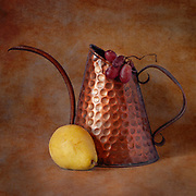 Still life of watering can and pear with vintage treatment.