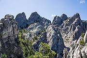 Granite pinnacles soar above krumholtz trees atop Castle Dome Trail in Castle Crags State Park, just west of Interstate 5, between the towns of Castella and Dunsmuir, in California, USA. One of my favorite hikes in the state is to Castle Dome, on an excellent trail 5.8 miles round trip with 2100 feet gain. Geology: although the mountains of Northern California consist largely of volcanic and sedimentary rocks, granite plutons intruded in many areas during the Jurassic period. Heavy Pleistocene glaciation eroded much of the softer surrounding rock leaving soaring crags and spires exposed. Exfoliation of huge, convex slabs of granite made rounded towers such as the prominent Castle Dome.
