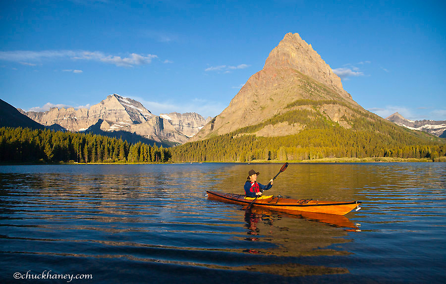 Kayaking in Swiftcurrent Lake at sunrise in the Many Glacier Valley of Glacier National Park, Montana, USA model released