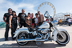 A group of Canadian bikers enjoys the sun at the Boardwalk Classic Bike Show during Daytona Beach Bike Week. Daytona Beach, FL, USA. March 13, 2015.  Photography ©2015 Michael Lichter.