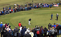 Fans watch England's Tommy Fleetwood on the 7th green during day three of the Betfred British Masters at Hillside Golf Club, Southport.