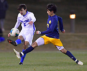 St. Louis University midfielder Christian Buendia gets to the ball before University of Missouri - Kansas City player Jony Munoz. St. Louis University played the University of Missouri - Kansas City in men's soccer on February 3, 2021 at Robert Hermann Stadium on the SLU campus in St. Louis, MO.<br /> Tim Vizer/For the Post-Dispatch