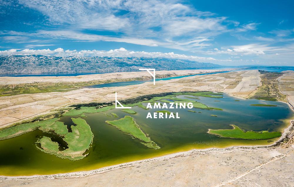 Aerial view of Jezero Velo Blato lake on the shoreline in Povljana, Croatia