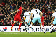 Adam Lallana of Liverpool shoots and scores his teams 1st goal. Premier League match, Liverpool v West Ham Utd at the Anfield stadium in Liverpool, Merseyside on Sunday 11th December 2016.<br /> pic by Chris Stading, Andrew Orchard sports photography.