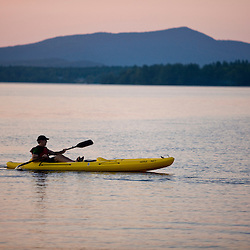 A kayaker on Umbagog Lake at Umbagog Lake State Park, Cambridge, New Hampshire.
