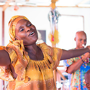 CAPTION: Rose Marie Etienne sings her heart out. Like all the members of Troupe Dahomey, she is passionate about traditional Creole music. But dedication to this work of course requires finances; passion alone will not keep the organisation going. In time, Dahomey hopes to become self-sustaining through three revenue-generating projects. The studio will produce and distribute music for other artists; the dance school will charge an entrance fee for shows and concerts it hosts; and, lastly, they will contract out musical equipment. ORGANIZATION: Troupe Dahomey / Sant Pont Ayiti (SPA). LOCATION: La Fleur du Chaine, Rue Capois, Port-au-Prince, Haiti. INDIVIDUAL(S) PHOTOGRAPHED: Rose Marie Etienne.