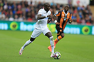 Modou Barrow of Swansea city in action. Premier league match, Swansea city v Hull city at the Liberty Stadium in Swansea, South Wales on Saturday 20th August 2016.<br /> pic by Andrew Orchard, Andrew Orchard sports photography.