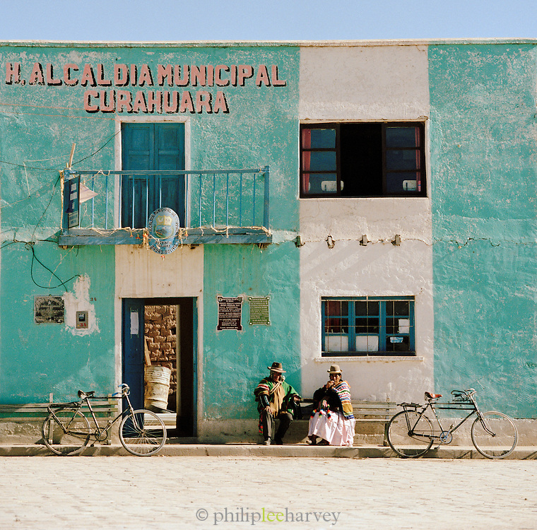 People sitting in the town of Curahuara, La Paz department, Bolivia