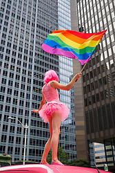 United States, Washington, Seattle Gay Pride Parade, June 28th, 2015. Cross-dressing dancer on top of pink van.