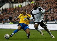 Photo: Steve Bond/Richard Lane Photography. Derby County v Crystal Palace. Coca Cola Championship. 06/12/2008. Shaun Derry (L) clears in front of Nathan Ellington (R)