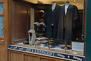 Court dress wigs and gowns for the legal profession barristers and judges in the window of Ede & Ravenscroft, on 15th February 2017, in London, United Kingdom. Ede & Ravenscroft is thought to be the oldest firm of tailors in the world. In 1689, the area of London now known as Aldwych, was the bustling centre of the tailoring trade. They have been tailors and robemakers of choice for twelve coronations. Today the firm continues to service royalty, the judiciary, civic authorities, academia and business.