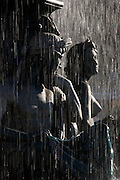 Statues in part of a water fountain on a local square, Praca Dom Pedro IV, in Lisbon, Portugal