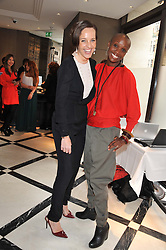 Left to right, JULIA BRANGSTRUP and TIFFANY PERSONS the founder and director of Shine On Sierra Leone at a lunch to launch Cash & Rocket on Tour 2013 hosted by Julia Brangstrup in aid of Orpan Aid and Shine on Sierrra Leone held at Banca, 40 North Audley Street, London on 29th April 2013.