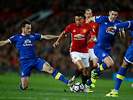 Jesse Lingard of Manchester United tackled by Leighton Baines of Everton during the English Premier League match at Old Trafford Stadium, Manchester. Picture date: April 4th 2017. Pic credit should read: Simon Bellis/Sportimage