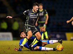 Ollie Clarke of Bristol Rovers is tackled by Conor Wilkinson of Gillingham - Mandatory by-line: Robbie Stephenson/JMP - 16/12/2017 - FOOTBALL - MEMS Priestfield Stadium - Gillingham, England - Gillingham v Bristol Rovers - Sky Bet League One
