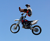"""Jul 01, 2003; Anaheim, California, USA; Moto X star athlete RONNIE RENNER executing a tremendous stunt feet free with a full sized motobike at the opening of Disney's California Adventure """"X Games Experience"""".  Disney park has built two X-Arena's specifically for this 41 day event highlighting extreme sports for the launch of the 2003 ESPN X Games.<br />Mandatory Credit: Photo by Shelly Castellano/Icon SMI<br />(©) Copyright 2003 by Shelly Castellano"""