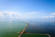 Nederland, Noord-Holland, Den Oever, 05-08-2014; Afsluitdijk  gezien vanuit Friesland richting Noord-Holland. Kornwerderzand.  Rechts Waddenzee, links IJsselmeer.<br /> Enclosure Dam in the direction of the coast of North Holland. Frisian coast.  Right Waddenzee, IJsselmeer left..<br /> luchtfoto (toeslag op standaard tarieven);<br /> aerial photo (additional fee required);<br /> copyright foto/photo Siebe Swart.