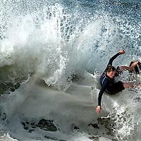 Andrew Moriates of Laguna Beach slashes the lip during the mens 18-21 year old semi finals at the 8th annual O'Neill Skimbash skimboarding contest at 26th Avenue beach in Santa Cruz, California.<br /> Photo by Shmuel Thaler <br /> shmuel_thaler@yahoo.com www.shmuelthaler.com