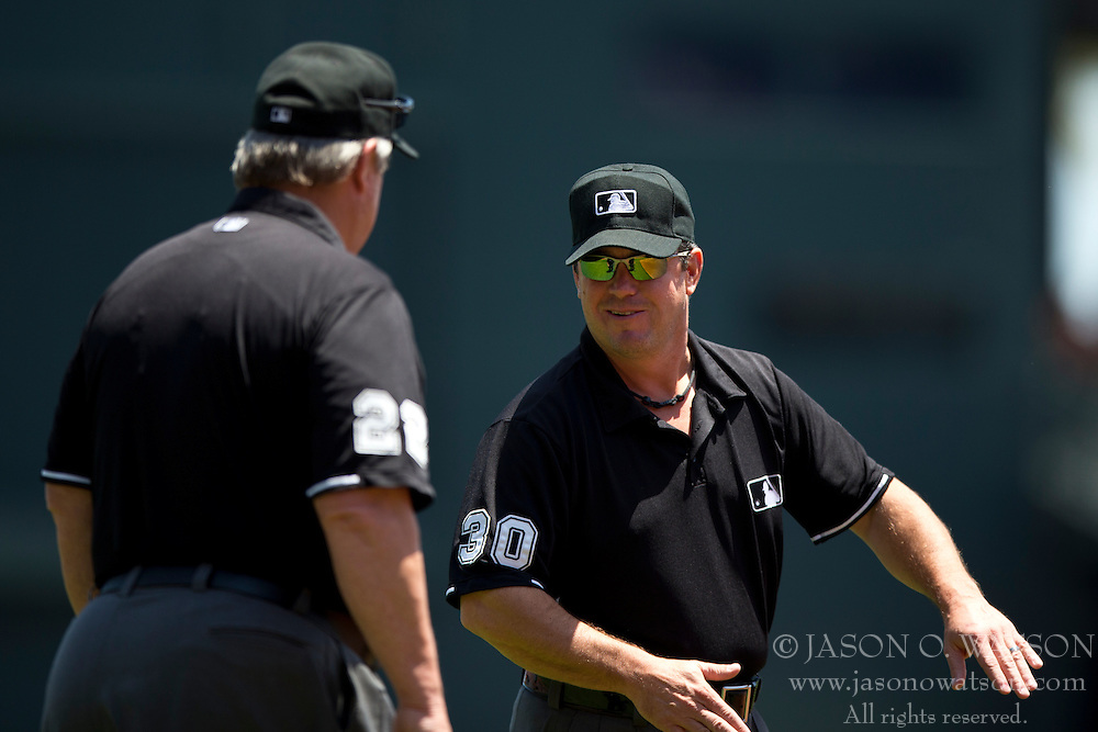 SAN FRANCISCO, CA - JUNE 08:  MLB umpire Rob Drake #30 talks to umpire Joe West #22 before the game between the San Francisco Giants and the New York Mets at AT&T Park on June 8, 2014 in San Francisco, California.  The San Francisco Giants defeated the New York Mets 6-4.  (Photo by Jason O. Watson/Getty Images) *** Local Caption *** Joe West; Rob Drake