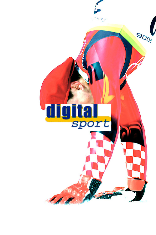 Photo: Catrine Gapper.<br /> Winter Olympics, Turin 2006. Alpine Skiing Men's Combined Slalom. 14/02/2006. Kostelic Ivica celebrating his win of the silver with a handstand.