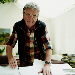PARIS, FRANCE. NOVEMBER 23, 2012. Belgian photographer Harry Gruyaert from Magnum Photo in his home, while organizing test prints of his new photo book. Photo: Antoine Doyen
