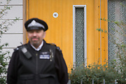 Guarded by police officers is the address in Peckford Place, on the Angell estate in south London, identified as the location where - including another location(s) - three woman were held captive for a 30 year period by two others, said to be in bad conditions. A 30-year-old British woman, a 57-year-old Irish woman and a 69-year-old Malaysian woman are deeply traumatised and in the protection of the 'Freedom Charity' whom they first contacted about their enslavement. The couple accused of their captivity have been bailed.