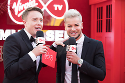 EDITORIAL USE ONLY<br /> Chris Hughes (right) spills the beans to Virgin TV's red-carpet host Roman Kemp in Virgin TV's Must-See Moment Lounge at the Virgin TV British Academy Television Awards.