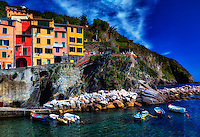 """""""Cinque Terre from the sea preparing the boats in Riomaggiore""""….<br /> <br /> I began my daily journey at the northern most town of Monterosso and took the train to the southernmost town of Riomaggiore. Upon arriving in this picturesque seaside village and moving down to the water's edge, I noticed proprietor Francesco in front of a tiny boat rental sign.  After arranging an evening sail up the coast, I was able to focus on the colorful persona of Riomaggiore. That evening I sailed up the coast photographing each Cinque Terre town along the way aboard the Angelina Dada. Upon arriving back home in Monterosso, soft light illuminated the sky and azure sea of the Mediterranean convincing me to sail all the way back to Riomaggiore with my gracious guides Claudio and Eddie of """"Cinque Terre dal Mare"""" sailing excursions. We arrived just in time for a perfect sunset. After a nice dinner...I caught the last train at midnight back home to Monterosso. A very long day, but worth every minute!"""