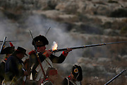 Napoleonic French re-enactors fire on Maltese defence positions during a re-enactment of the French invasion of Malta in 1798, at Mistra Bay outside Mellieha, Malta June 6, 2018.  REUTERS/Darrin Zammit Lupi