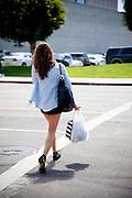 Female Shopper Crossing Street