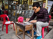 27 DECEMBER 2017 - HANOI, VIETNAM: A shop that sells grave markers in the old quarter of Hanoi.      PHOTO BY JACK KURTZ